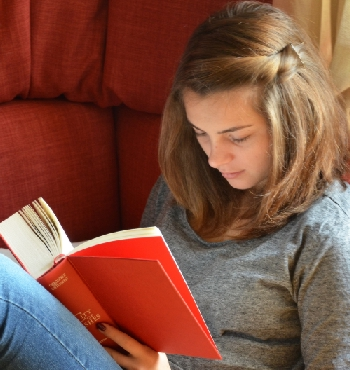 student studying book